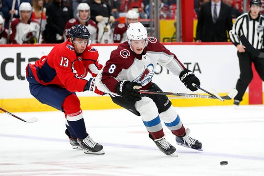 Colorado Avalanche defenseman Cale Makar, right, battles for the puck with Washington Capitals left wing Jakub Vrana  during the second period at Capital One Arena in Washington, D.C.