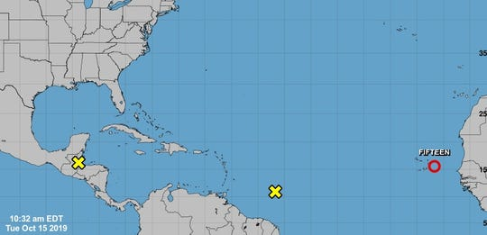Forecasters are monitoring Tropical Depression 15 (red circle near Africa) and a weather disturbance over Central America (yellow x). The other disturbance (the yellow x near South America) has little chance of developing.
