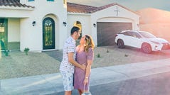 Sarah Tripp, who runs a fashion blog, and her husband Robbie lived in San Francisco for two years before deciding their money would go a lot farther somewhere else. Here they stand in front of the new home they purchased in Phoenix, where they will raise their newborn.