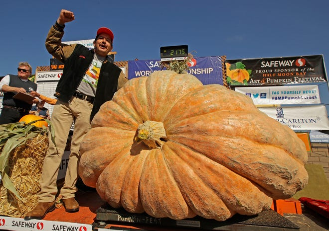Leonardo Urena of Napa, Calif., reacts after learning his pumpkin weighed in at 2,175 lbs., a new California weight record on Monday, Oct. 14, 2019, in Half Moon Bay, Calif.