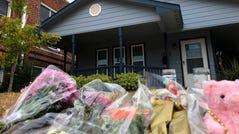 Bouquets of flowers and stuffed animals sit Monday in front of the Texas home where Atatiana Jefferson, a 28-year-old black woman, was shot to death by a white police officer, Aaron Dean.