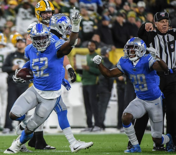 Detroit Lions linebacker Christian Jones (52) reacts after recovering a fumble in the first quarter against the Green Bay Packers.