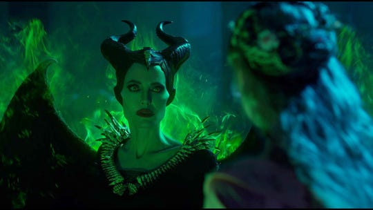 "Maleficent (Angelina Jolie, left) lets loose some dark magic in the presence of adopted daughter Aurora (Elle Fanning) in ""Maleficent: Mistress of Evil."""