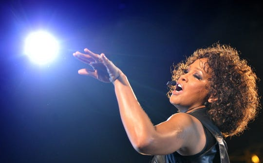 """Whitney Houston performs on stage during her concert as part of her tour """"Nothing But Love"""" in Berlin on May 12, 2010."""