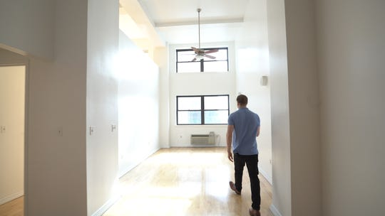 Fuchs gives a tour of his new duplex  which he bought for $292,000.