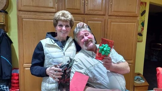 "Kevin ""Hollywood"" Hein, right, and Mary Coenen at a Christmas party in 2017."