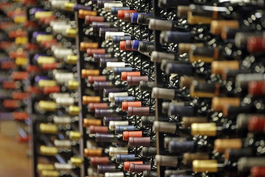 In this June 16, 2016, file photo, bottles of wine are displayed during a tour of a state liquor store, in Salt Lake City. The tariffs the Trump administration is about to impose on wine, liquor and cheese from Europe couldn't come at a worse time for small retailers.