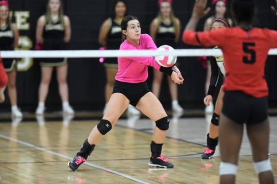 Abilene High libero Maddie Perez (3) reaches to return a serve against Euless Trinity at Eagle Gym on Tuesday, Oct. 15, 2019. Perez had a team-high 20 digs in the Lady Eagles three-set loss.