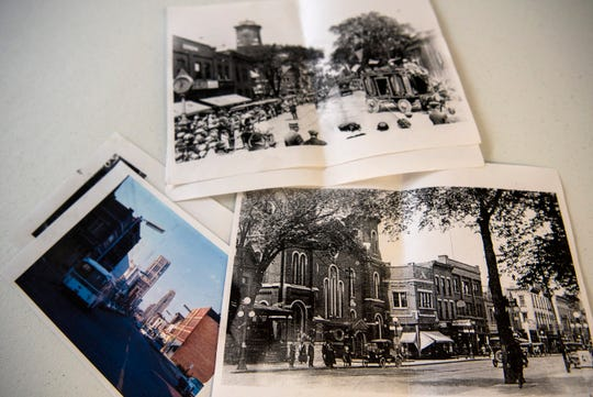 Historical photographs of 70 E. Michigan Ave. are pictured Wednesday morning on Oct. 16, 2019 in downtown Battle Creek, Mich. Sarah and her husband Jeff purchased the historical building in May to renovate into affordable housing, an issue of accessibility realized during their search to move downtown and into the heart of a city they love.