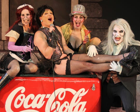 "Penelope Alex as Magenta, Alan Palmer as Frank N Furter, Samantha Rickard as Columbia and Brendan Ragotzy as Riff Raff in the Barn Theatre production of ""Rocky Horror Show."""