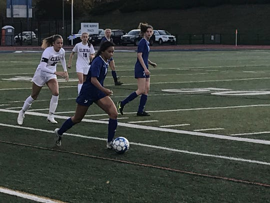 Maine-Endwell's Trish Wilber pushes the ball forward during Tuesday's Southern Tier Athletic Conference semifinal against visiting Elmira. The teams played to a 1-1 all tie through regulation and overtime before Wilbur scored the deciding goal in a penalty-kick shootout.