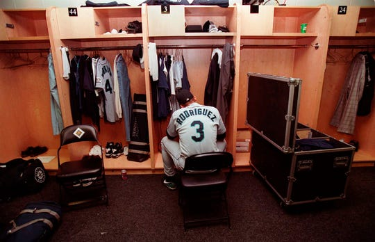In this Oct. 5, 1997, file photo, Seattle Mariners' Alex Rodriguez sits in the locker room following their 3-1 loss to the Baltimore Orioles in Game 4 of the American League Division Series at Camden Yards in Baltimore. The Seattle Mariners are the only baseball franchise never to advance to the Fall Classic. Baseball has never been played in Seattle beyond Oct. 22. The Mariners have three times been to the American League Championship Series, and all three times were sent home before there could ever be a Game 7.