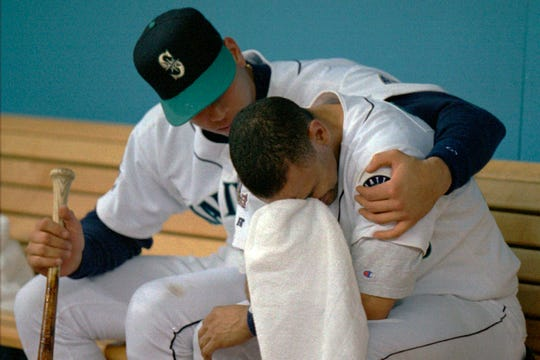 The Mariners' Alex Rodriguez, left, comforts teammate Joey Cora in the Mariners' dugout following the team's loss to the Cleveland Indians in the 1997 American League Championship Series. The Seattle Mariners are the only baseball franchise never to advance to the Fall Classic. Baseball has never been played in Seattle beyond Oct. 22. The Mariners have three times been to the American League Championship Series, and all three times were sent home before there could ever be a Game 7.