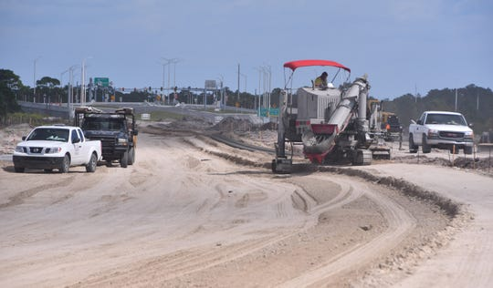 """Crews are shaping Palm Bay's St. Johns Heritage Parkway """"connector road"""" linking the new Interstate 95 interchange with Babcock Street."""