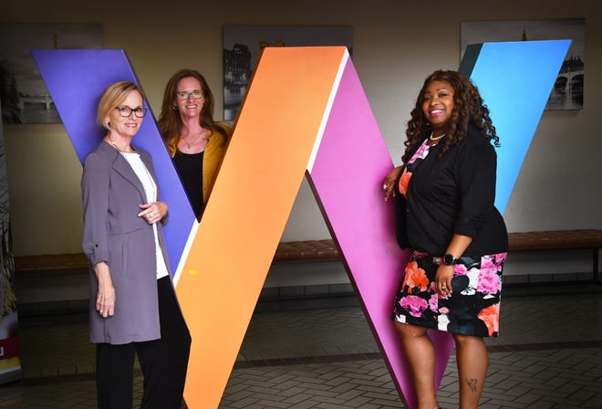 "weVENTURE mission is to accelerate sustainable business growth for women entrepreneurs. Left to right: Susan Erickson, Kathy Register and Val Williams with their big ""W"" that they take with them for promoting weVENTURE."