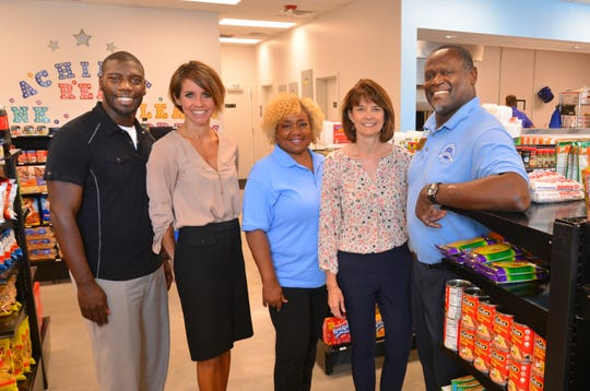 Inside the Evans Market at the Evans Center are Trevor Howard with The Dock,  Brandy Bean, LeAngela Aiken, Lynn Brockwell-Carey and market manager Art Derico.