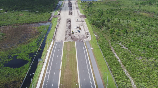 "Looking west on Sept. 30, a drone photographs construction of Palm Bay's St. Johns Heritage Parkway ""connector road"" linking the new Interstate 95 interchange with Babcock Street."
