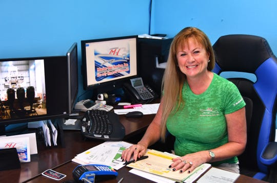 Marine One Services Inc. at Port Canaveral is nominated for Business of the Year, with the company praised for its efforts to help animals in need. Michelle Nicholas, owner and vice president, is pictured in her Port Canaveral office.