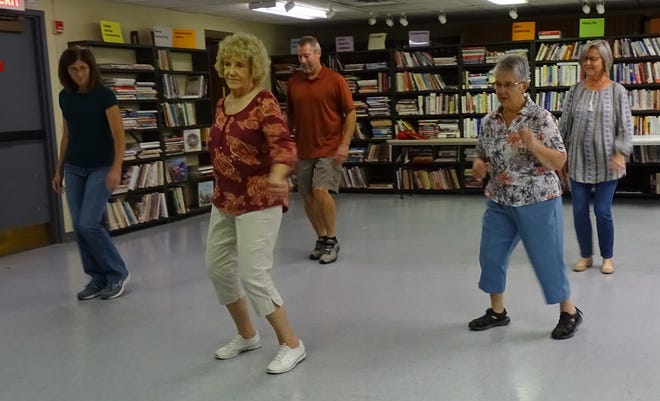 Peggy McBride leads a line dancing class on Monday at the Bucyrus Public Library. From left are Cassie Powers, McBride, Bob Powers, Lenora Matula and Linda Kinney. Classes are offered at 9 a.m. Monday, 6 p.m. Tuesday and 4 p.m Thursday.
