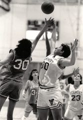 Vermont's Sheri Turnbull, right, fights for a loose ball during a women's basketball game against Maine.