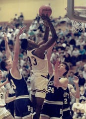 Kevin Roberson seen in action for the University of Vermont men's basketball team.