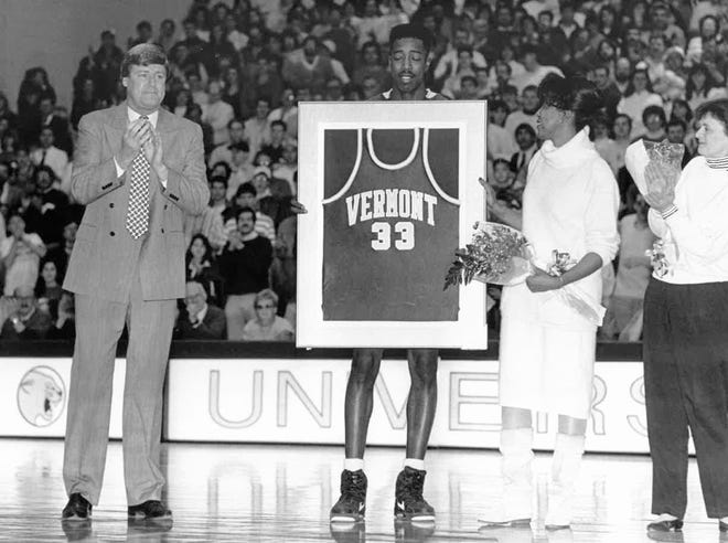 University of Vermont star Kevin Roberson is given a jersey on senior night at Patrick Gym.