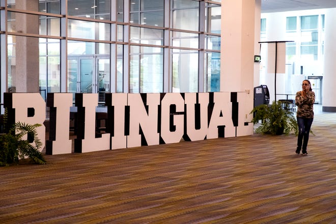 A woman walks past a bilingual sign at the Texas Association for Bilingual Education annual conference on Wednesday, October 16, 2019 at the American Bank Center.