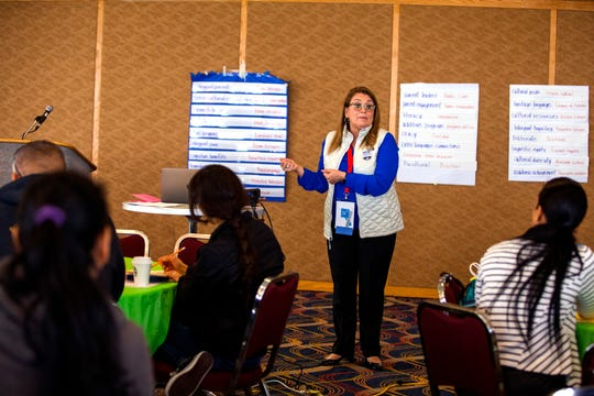 Olivia Hernandez, assistant superintendent for bilingual ESL and migrant students at San Antonio ISD, talks with parents during a Texas Association for Bilingual Education annual conference on Wednesday, October 16, 2019 at the American Bank Center.