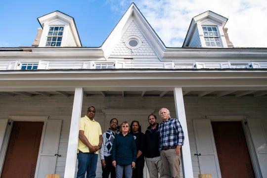 Rev. Harold Harris, from left, Deacon Hampton Taylor, Barbara Dreyfuss, Lynda Townes, Zack Mullock and Bob Mullock pose in front of the Harriet Tubman Museum last fall in Cape May.