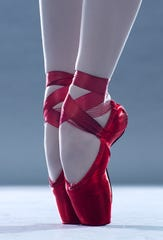 Since this is ballet, Dorothy's ruby slippers have morphed into ruby pointe shoes, painstakingly decorated by members of Cincinnati Ballet's wardrobe department. The feet belong to principal dancer Melissa Gelfin, who will perform the role.
