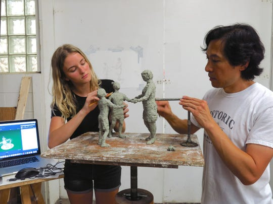 Artists Tom Tsuchiya and Gina Erardi are responsible for designing and sculpting the statue.