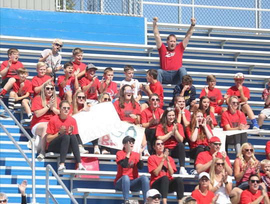 Parents from the Kings youth football league cheer on Hughes during its football game Saturday, Oct. 6, 2019.