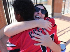 A need. One mom. An army of support. How Hughes High School football and Kings youth team bonded.