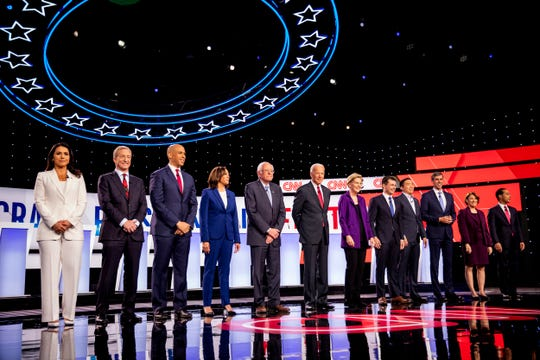 Democratic presidential candidates stand on stage at Otterbein University in Westerville, Ohio, for the Democratic Presidential Debate on Oct. 15.