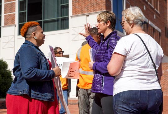 "Diane Jenkins, left, speaks with passersby about her and her family's ""Justice for Jalen"" movement and the courts system in Clarksville at Montgomery County Court in Clarksville, Tenn., on Wednesday, Oct. 16, 2019."