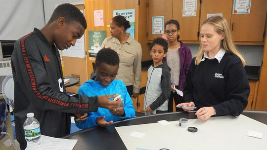 Union Catholic students demonstrate science lab experiments to prospective students and families at the Wednesday, Oct. 9, open house.