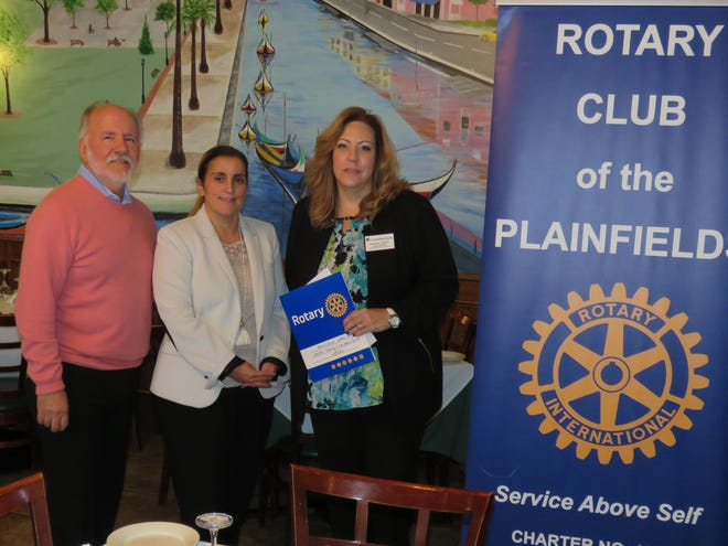 Tom Reedy and President Shannon Jefferys pose with Manuela Garcia, center, at her induction into the Rotary Club of the Plainfields. The induction took place at a regular weekly club meeting at Paulo's Restaurant in South Plainfield.