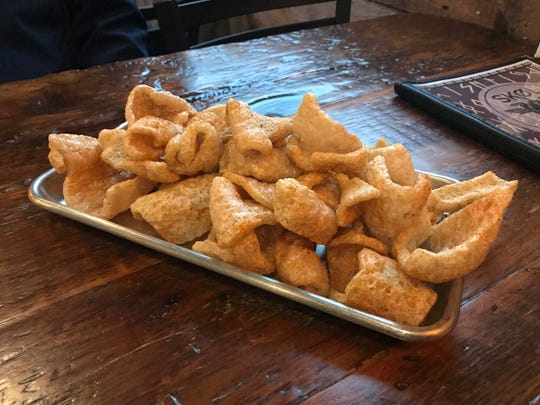 The BBQ Pork Rinds from SKØL in East Village.