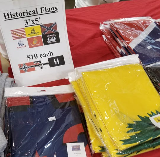 Flags, including one with a Nazi swastika.  A U.S. Senate candidate has complained the items were for sale at a gun show at the Iowa State Fairgrounds.