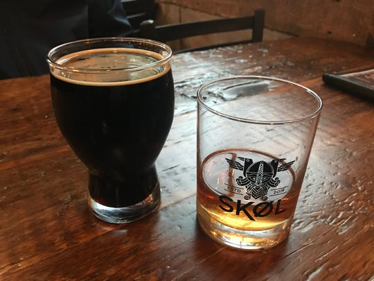 A glass of Confluence Milk Man Milk Stout and a pour of Dansk Mjod Viking Blod from SKOL in East Village.