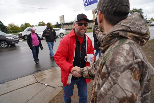 UAW Local 598 president Ryan Buchalski spreads the news to strikers outside General Motors Flint Assembly in Flint after it was announced GM and the UAW had reached a proposed tentative agreement on Wednesday, Oct. 16, 2019.