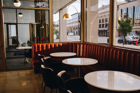 The Patrick Thompson-designed interior of the Hammer & Nail bar on the ground floor of The Plaza building in Midtown honors the mid-century era of the historic building, formerly known as the Hammer & Nail.