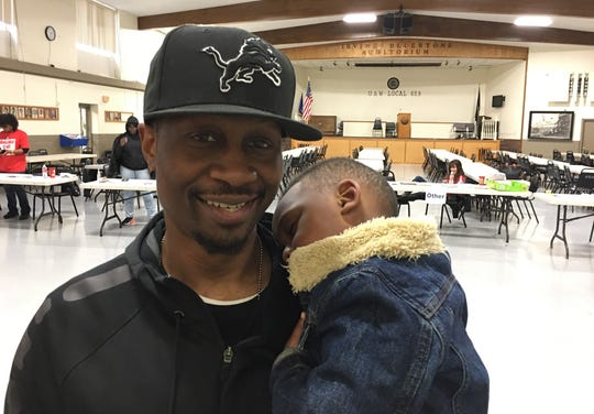 Ricky Callaway, 38, of Flint with his son Carter.