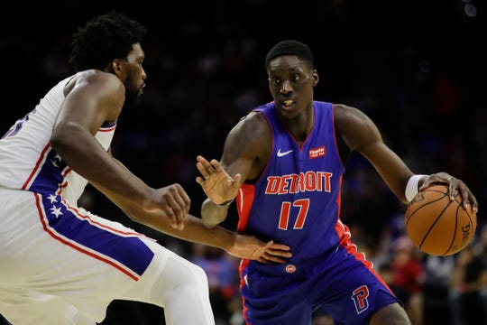 Detroit Pistons' Tony Snell is defended by Philadelphia 76ers' Joel Embiid during the first half of a preseason game Tuesday, Oct. 15, 2019, in Philadelphia.