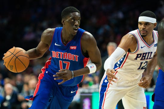 Detroit Pistons guard Tony Snell drives past Philadelphia 76ers forward Tobias Harris during the second quarter of a preseason game Tuesday, Oct. 15, 2019, in Philadelphia.