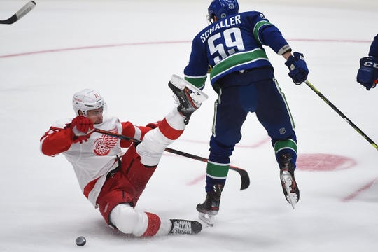 Vancouver Canucks forward Tim Schaller (59) checks Detroit Red Wings forward Dylan Larkin (71) during the third period at Rogers Arena on Tuesday, Oct. 15, 2019, in Vancouver.