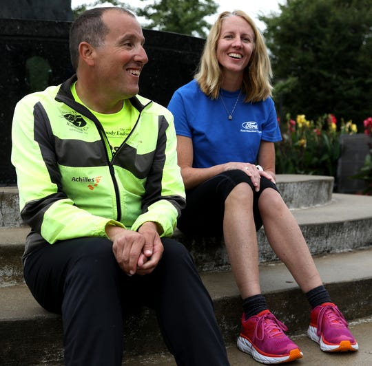Michigan Supreme Court Justice Richard Bernstein talks with his marathon guide Sara Reichert.