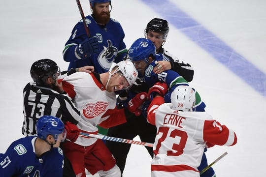 Red Wings forward Anthony Mantha and Canucks forward Brandon Sutter fight during the third period of the Wings' 5-1 loss on Tuesday, Oct. 15, 2019, in Vancouver, British Columbia.