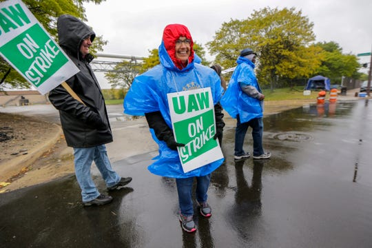 UAW Autoworker Adriana Jaime, 59, of Detroit has worked for 21 years at the General Motors Detroit-Hamtramck plant in Hamtramck, Mich. and walks the picket line with other UAW members on Wednesday, Oct. 16, 2019. General Motors and the UAW reached a proposed tentative agreement on a new contract Wednesday, the 31st day of a nationwide strike.