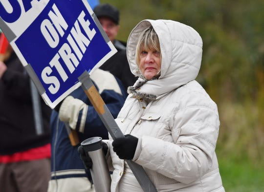 "Sheila Dallas, a 42-year GM employee picketing at the Romulus Powertrain plant, heard about the tentative agreement Wednesday but noted that ""We still have to vote and ratify it before we go back to work."""